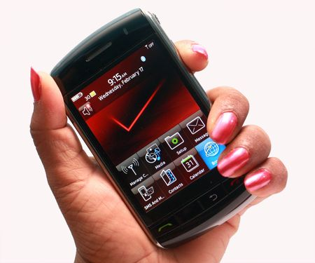 touch screen mobile phone in lady hand Stock Photo