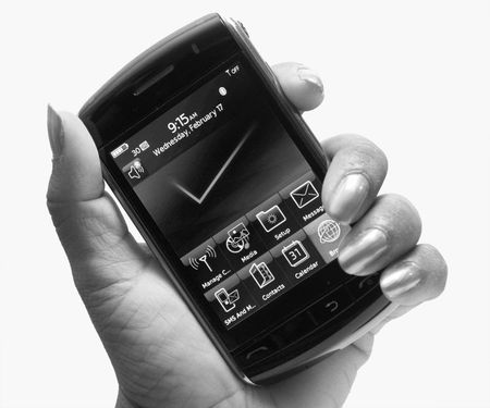 touch phone in hand Stock Photo