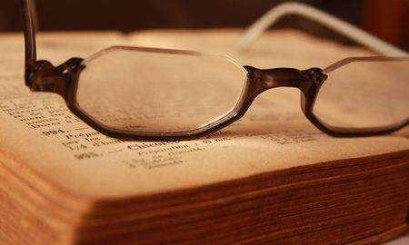 spectacles on the book