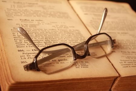 spectacles on the book Stock Photo
