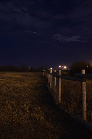 Fence Line taken at night Banco de Imagens - 92155487