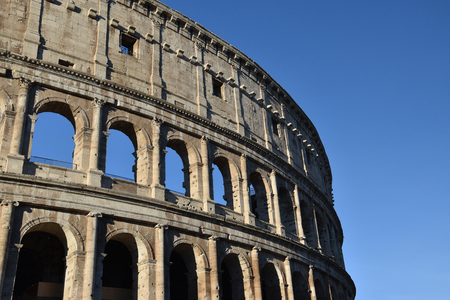Exterior of the Colosseum against a bright blue sky Stock Photo
