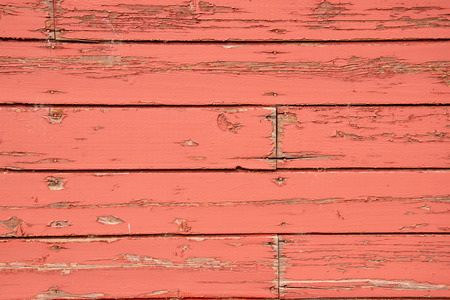 Aging boards on the side of an old red barn. Stock Photo