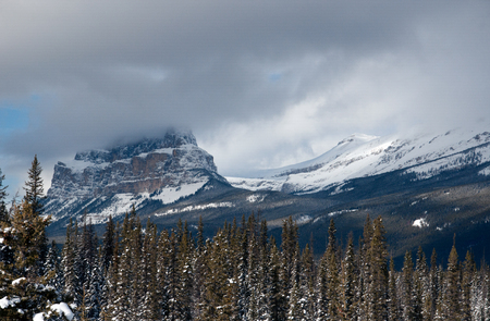 Fog over Castle Mountain in the Rocky Mountains, Alberta, Canada