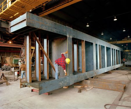 steel works: Steel Worker - Steel Fabrication of a Bridge Girder Stock Photo