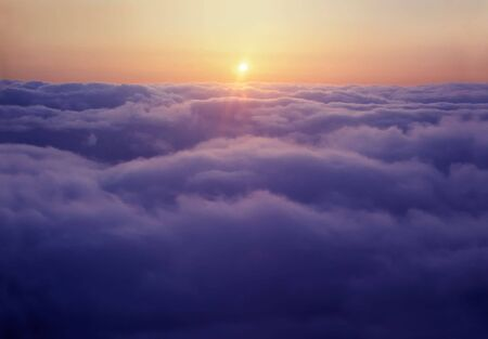 Flying above the clouds, at sunset Stock Photo - 3395160