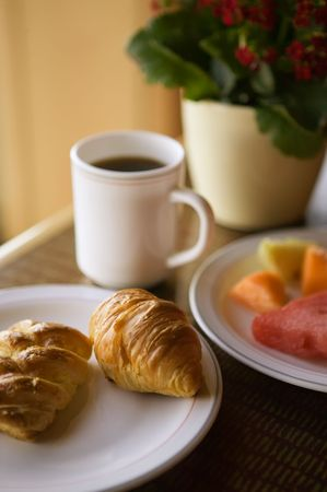 Continental breakfast of coffee, pastry, and fresh fruit