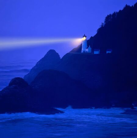 beaming: Light beaming across stormy, night sea - Heceta Head, Oregon Stock Photo