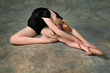 contortion: Young women doing ballet stretching warm-up exercise