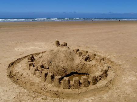 sand mold: Sand castle on the ocean beach