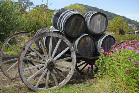 wine barrels on wagon with flowers