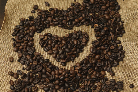 heart made of coffee beans on burlap