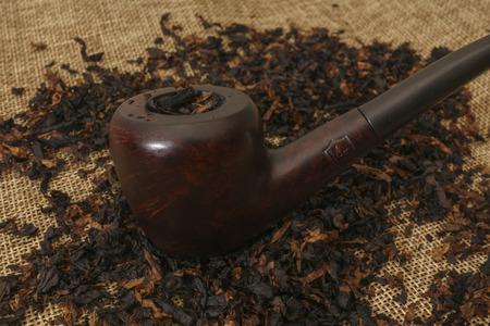 bent briar tobacco pipe on burlap