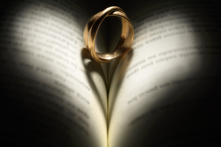 poems: nother twist ring with book and heart shaped shadow Stock Photo