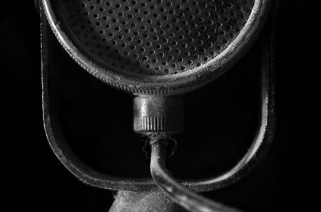 amplify: old black microphone on dark background