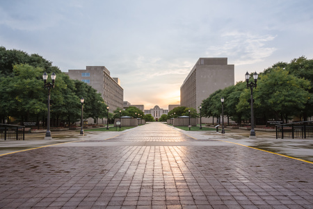 Lansing michigan state court at sunset with a reflection through the city Archivio Fotografico