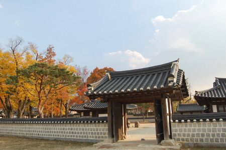 Traditional korean wall and gate in the Jeonju Hanok Village in autumn. Stock Photo