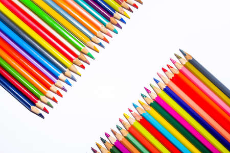 Two rows of colored pencils separated by a diagonal white stripe