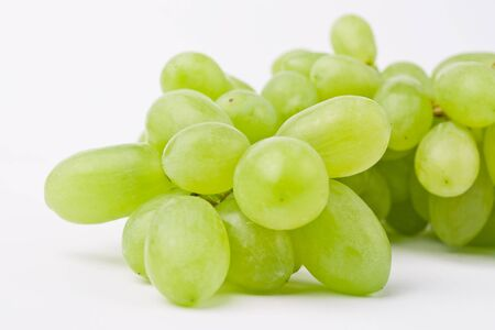 vinery: white grapes close-up isolated on white