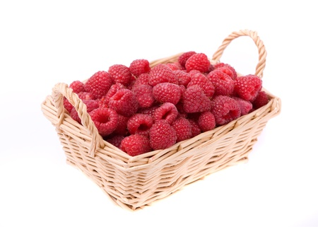 fresh raspberries in the wicker basket isolated on white Stock Photo - 10835621