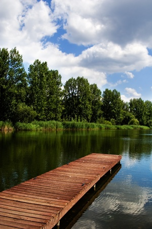 A wooden dock / pier on a lake in summer sunny day Stock Photo - 10943844