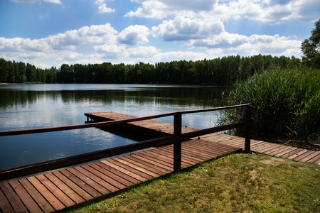 wooden dock / pier on a lake in summer sunny day Stock Photo - 10943845