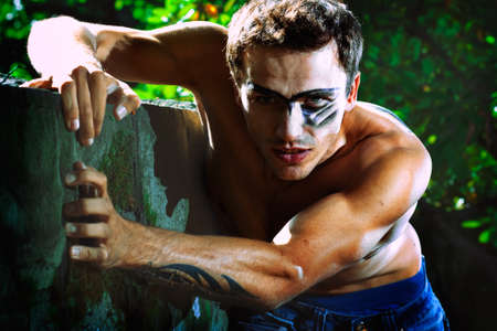 bodypainting: portraiture of hard military handsome male model