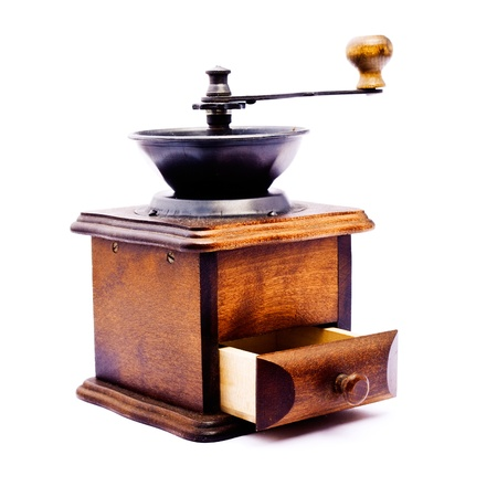 wooden coffee grinder with open drawer - made in studio isolated on white background photo