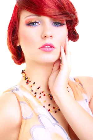 Portrait of beauty red hair female model made in studio on white background photo