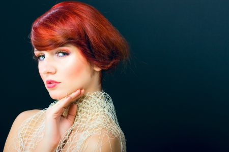 Glamour portraiture of beautiful young red hair female model woman photo