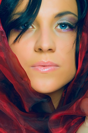 portrait of beauty woman, female model, in red scarf photo