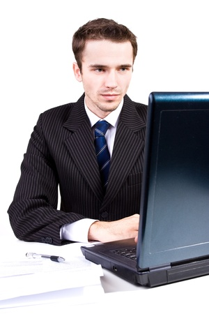 Handsome businessman working in white office computer photo