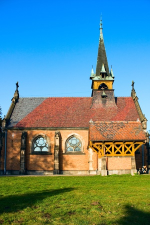 Gothic catholic church on blue sky, Swierklaniec, Poland, Europe photo