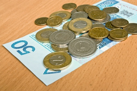 polish money - zloty, banknotes and coins on the table photo
