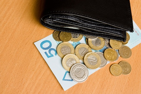 payola: Polish money - zloty, banknotes and wallet on the table