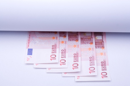 europe money euro, banknotes under roll of paper for text or design photo