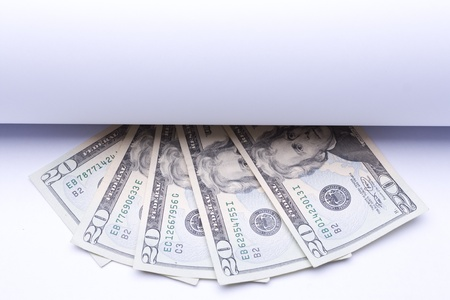 us money dollar, banknotes under roll of paper for text or design photo
