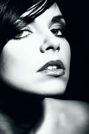 black woman face: attractive woman face, female model portrait, high contrast black and white scene, studio shot  Stock Photo