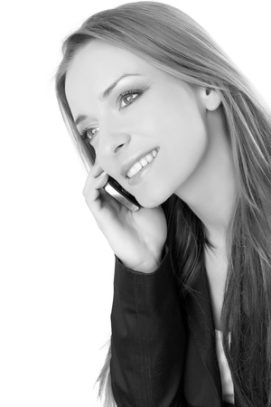 smiling woman calling by mobile phone, black and white version Stock Photo - 12309314
