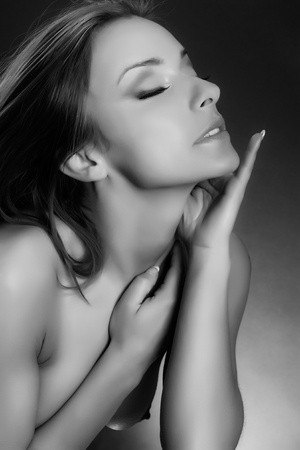 beauty topless girl portrait in desire pose , black and white version photo
