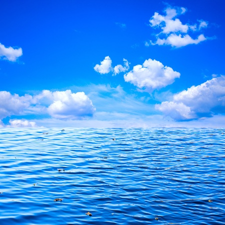 beautiful view of blue sky with white clouds and ocean as background to design Stock Photo - 12311911