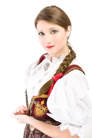 Beauty woman in traditional Polish clothes Cieszyn Silesia region, studio shot on white background photo