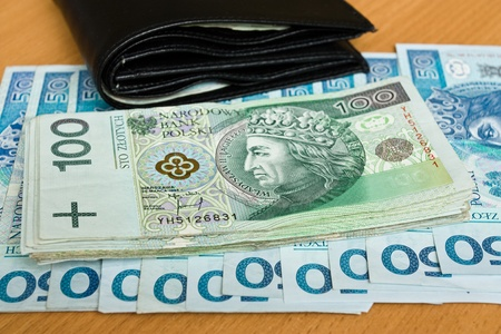 polish money - zloty, banknotes and wallet on the table Stock Photo - 12407305