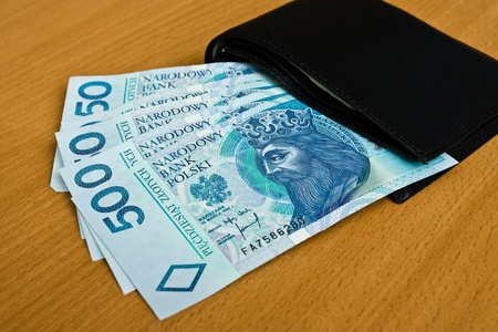 polish money - zloty, banknotes and wallet on the table photo