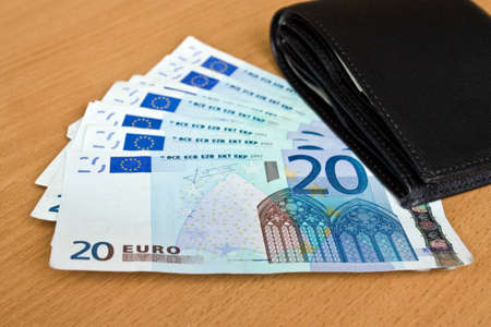 euro, europe money, banknotes and wallet on the table Stock Photo - 12312959