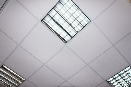 electric grid: fluorescent lamp on the modern ceiling Stock Photo