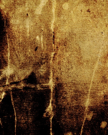 patched: aged yellow parchment, old rusty paper as vintage background for insert text or design