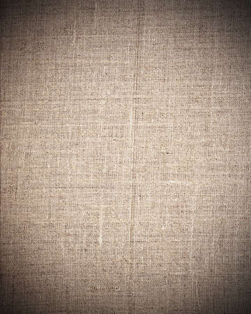 dark beige: aged beige fabric as vintage background for insert text or design  Stock Photo