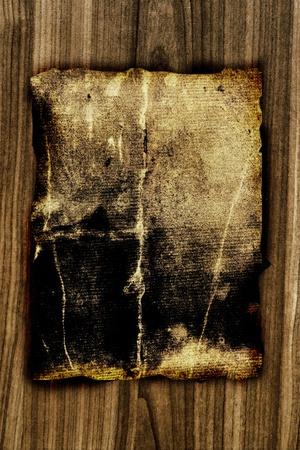 old cowboy: dark old paper on wooden board