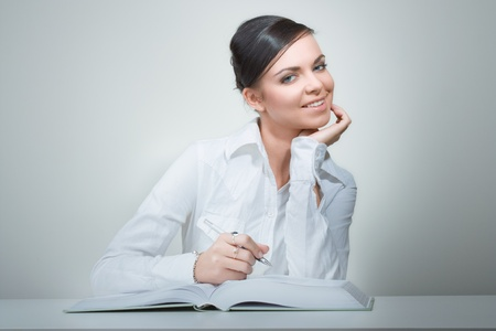 sexy teacher: beauty woman in office reading book and note